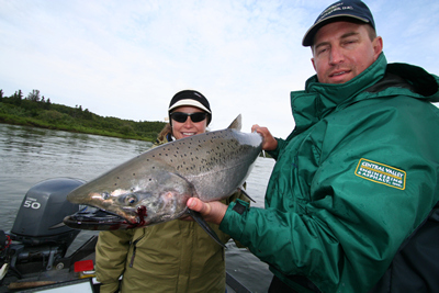 An alaska king salmon adventures client poses with a salmon caught while fishing on the nushagak river