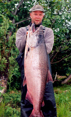A man holds his salmon that he caught on the nushagak river