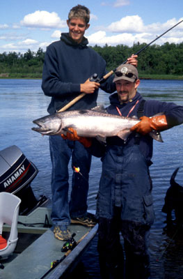 Posing with a salmon caught on alaska's nushagak river near alaska king salmon adventures's fishing lodge